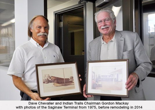 Dave Chevalier and Indian Trails Chairman Gordon Mackay with photos of the Saginaw Terminal from 1975, before remodeling in 2014