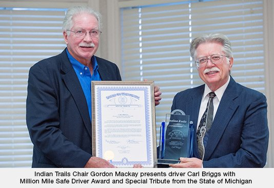 Indian Trails Chair Gordon Mackay presents driver Carl Briggs with Million Mile Safe Driver Award and Special Tribute from the State of Michigan